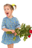 Charming little girl holding a bouquet of red roses. — Foto Stock