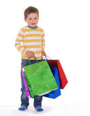 Little boy with packages. — Stock Photo