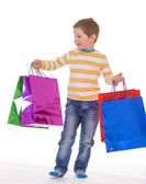 Little boy with packages. — Foto Stock