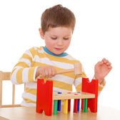 Little boy playing at the table — Stock Photo