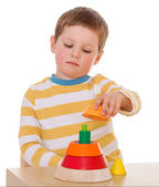 Little boy plays with a pyramid — Stock Photo