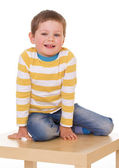 Little boy is sitting on the table. — Stock Photo