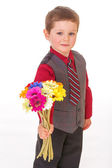 Little boy with flowers. — Stock Photo