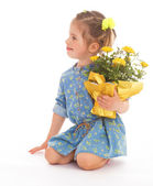 Charming little girl holding a flower bouquet. — Stock Photo