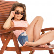 Little girl on a sunbed — Stock Photo #46505805