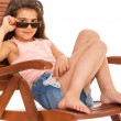 Little girl on a sunbed — Stock Photo #46505807
