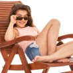 Little girl on a sunbed — Stock Photo #46505819