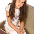 Little girl sitting in a suitcase — Stock Photo
