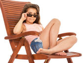Little girl on a sunbed — Stock Photo