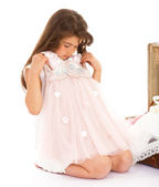 Little girl tries on a dress — Stock Photo