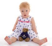 Charming little girl with teddy bear — Stock Photo