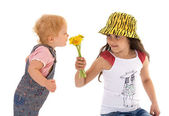 Sister gives sniff flowers — Stock Photo