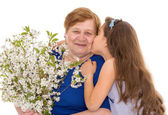 Grandmother and granddaughter with a bouquet — Stock Photo