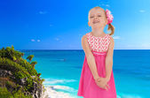Little girl on a background of blue sea — Stock Photo