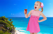 Girl on a background of blue sea  — Stock Photo