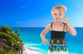 Little girl on a background of blue sea — Stok fotoğraf