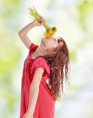 Little girl with yellow flowers — Stock Photo