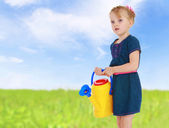 Igirl with a yellow watering can — Stock Photo