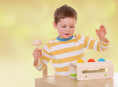 Board game a little boy — Stock Photo