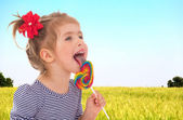 Girl licks ledinets lolly — Stock Photo