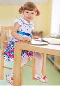 Cheerfully smiling little girl — Stock Photo