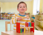 Little boy to school in the Montessori — Stock Photo