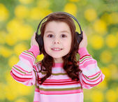Girl with big black headphones — Stock Photo