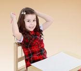 Little girl holding a pen. — Stock Photo