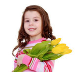 Young girl with a bouquet of flowers — Stock Photo