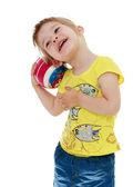 Little girl hugging the ball. — Stock Photo
