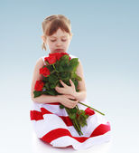 Child with flowers — Stock Photo