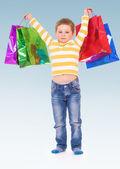 Boy goes shopping. — Stock Photo