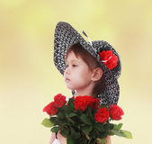 Girl in a hat with a bouquet of flowers. — Stok fotoğraf
