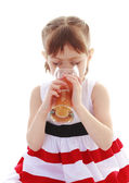 Girl drinking a glass of juice — Stock Photo