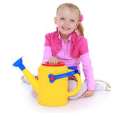 Girl holding a garden watering can. — Stock Photo