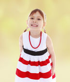 Girl in red beads — Stock Photo