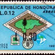 HONDURAS - CIRCA 1971: A stamp printed in Honduras shows Forest Fire Brigade emblem (with map of Honduras) and emblems of fire fighters, FAO and Alliance for Progress, circa 1971. — Stock Photo