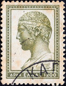 "GREECE - CIRCA 1954: A stamp printed in Greece from the ""Ancient Greek Art"" issue shows head of charioteer of Delphi, circa 1954. — Stock Photo"