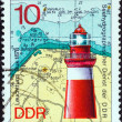 "GERMAN DEMOCRATIC REPUBLIC - CIRCA 1974: A stamp printed in Germany from the ""Lighthouses (1st series)"" issue shows Buk Lighthouse and marine map, circa 1974. — Stock Photo"