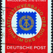 GERMAN DEMOCRATIC REPUBLIC - CIRCA 1969: A stamp printed in Germany shows badge of DDR philatelists' association, circa 1969. - Stock Photo