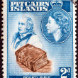 Stock Photo: PITCAIRN ISLANDS - CIRC1957: stamp printed in Pitcairn Islands shows John Adams, Bounty Bible and Queen Elizabeth II, circ1957.