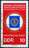GERMAN DEMOCRATIC REPUBLIC - CIRCA 1969: A stamp printed in Germany shows badge of DDR philatelists' association, circa 1969. — Stock Photo