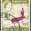 RHODESIA AND NYASALAND - CIRCA 1959: A stamp printed in Rhodesia shows Lake Bangweulu and a portrait of Queen Elizabeth II, circa 1959. - Stock Photo