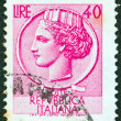 "ITALY - CIRCA 1953: A stamp printed in Italy from the ""Italy turreted (Syracuse)"" issue shows an Ancient coin of Syracuse, circa 1953. — Stock Photo #12263512"