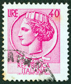 "ITALY - CIRCA 1953: A stamp printed in Italy from the ""Italy turreted (Syracuse)"" issue shows an Ancient coin of Syracuse, circa 1953. — Stock Photo"