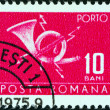 Stock Photo: ROMANIA - CIRCA 1967: A stamp printed in Romania shows a posthorn, circa 1967.