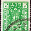 Stock Photo: INDI- CIRC1971: stamp printed in Indishows four Indilions capital of AshokPillar (refugee relief issue), circ1971.