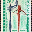 "Stock Photo: GABON - CIRC1970: stamp printed in Gabon from ""Gabonaise weapons, folk art museum, Libreville"" issue shows assegai and crossbow, circ1970."