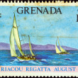 GRENADA - CIRCA 1973: A stamp printed in Grenada issued for the Carriacou Regatta shows Racing Class Yachts, circa 1973. — Foto de Stock