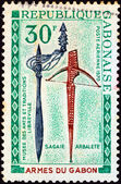 "GABON - CIRCA 1970: A stamp printed in Gabon from the ""Gabonaise weapons, folk art museum, Libreville"" issue shows assegai and crossbow, circa 1970. — Stock Photo"